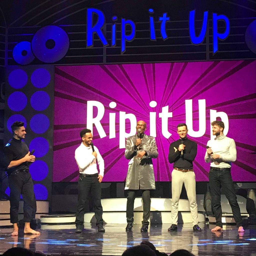 Rip It Up boys on stage with the host