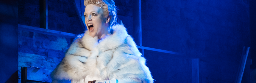A picture of the Show Queen in a white fur cape